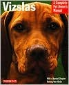 img - for Vizslas by Chris Pinney D.V.M., Rick Reason (Illustrator) book / textbook / text book