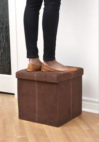 Woman standing on the FHE Group microsuede storage ottoman