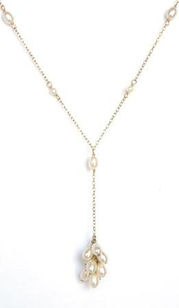 Amethyst's by Sara Lim white rice freshwater pearl 14k gold filled necklace.