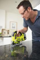 Man using Ryobi 18 V ONE+ jigsaw on home project