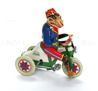 tin toys wind up metal cute monkey riding tricycle red blue green