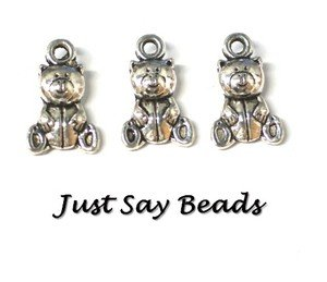10 x Antique Silver Plated 2D Bear Charms with Jump Rings included for attachments. Universal use for Jewellery Making, Card Making and Scrap-Booking. Check out our Fantastic Wide Range of Beads, Charms and Findings. (Ref:10A3)