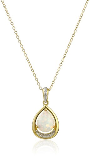 18k yellow gold and rhodiumplated sterling silver created