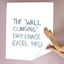 Wall clinging dry erase pad