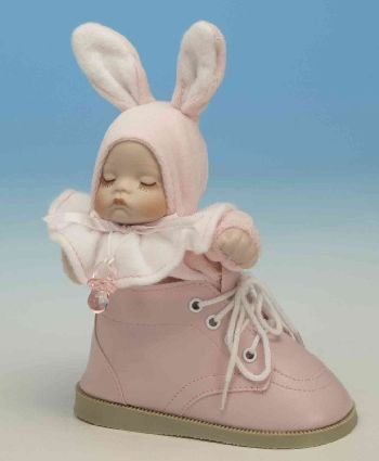 Charming baby in a shoe musical box - pink in colour