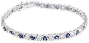 Platinum Plated Sterling Silver Created Blue Sapphire and White Simulated Diamond Alternating with Curved Bar Tennis Bracelet, 7.25