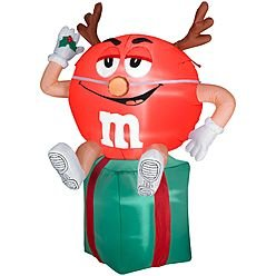Red M & M With Antlers Sitting On Present front-992469