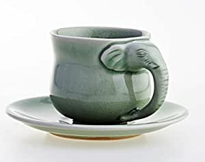 Antique Cup and Saucer Elephant Coffee cup and saucer in a jade-green crackling glaze unique exotic design