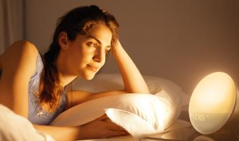 Woman using Wake-Up Light.
