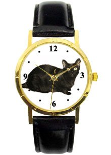 Black Cat watch classic size of 1.1/4 inch diameter Has gold tone case with black leather band. Battery operated.