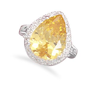 Pear shape yellow CZ fashion ring with clear CZs around the stone. / Size 9