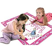 girls on playmat playing with aquadraw