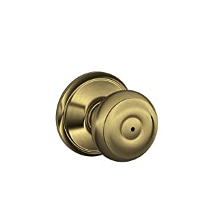 Schlage F40GEO609 Georgian Privacy Knob, Antique Brass