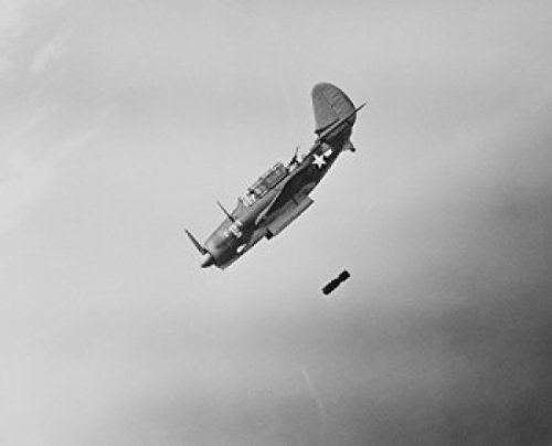 curtiss-sb2c-helldiver-lines-up-its-sights-on-a-target-before-loosing-its-deadly-missiles-poster-609