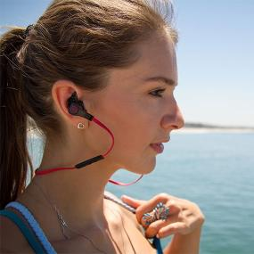 Outdoor Tech Orcas water resistant active wireless earbuds on a woman