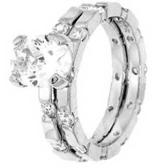 Sterling Silver Wedding Ring Set With Oval Cubic Zirconia in Four Prong Setting