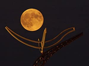 A Full Corn Moon Rises Above a Large Metal Sculpture on the Campus of the University of Minnesota