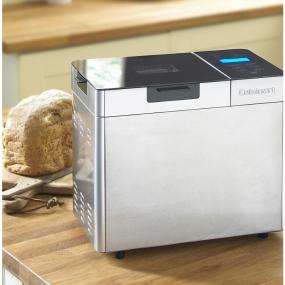 Cuisinart bread maker on kitchen counter with fresh loaf