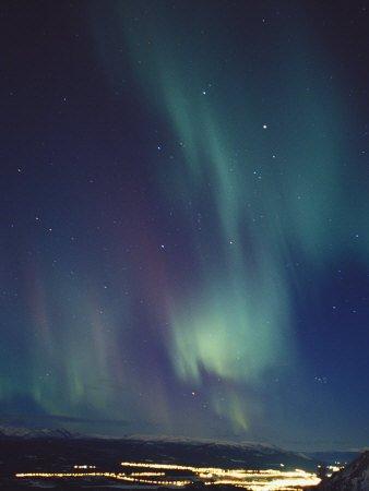 The Aurora Borealis over a City