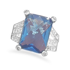 Faceted blue glass fashion ring with split CZ band. / Size 6