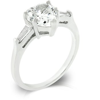 White Gold Rhodium Bonded Anniversary Ring Featuring Prong Set Heart Cut Clear CZ and Bar Set Clear Baguettes to Finish the Triplet in Silvertone