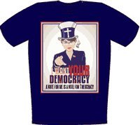 """Palin I want your Democracy in """"Patriotic"""" attire shirt $16.00 Price reduced!! A typically """"patriotic"""" pose by Ms. Palin in her Sunday best hat revealing her theocratic desire. This image clearly shows the Tea bag dangling from a cross-branded hat. Her obligatory lapel flag has flipped into a distress sign. The text at the bottom rightly proclaims that a vote for Sarah Palin is a vote for Theocracy (rule by pious religious bigots). For some strange reason the maker of this item used American App"""