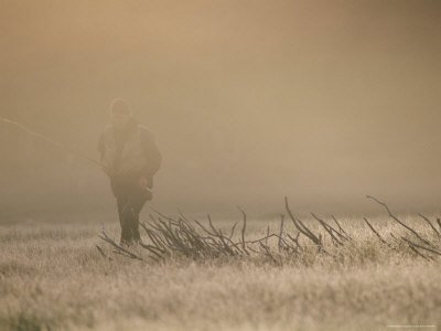 A Man Walks Through the Winter Mist