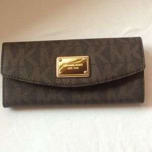 MICHAEL Michael KorsMichael Kors Items Slim Flap Wallet in Brown Pvc