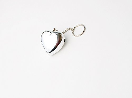 Our Exquisite Metallic Silver Heart Personal Alarm, Discreetly Designed to Look Like a Handbag Charm or Key Ring Attachment, Makes a Practical and Lasting Defense Accessory For You or Loved Ones. Alarm is Especially Great For The College Student and Blends Seamlessly With Purse/Backpack, Clothing, and Keys etc. This Unassuming Looking Alarm, With Its 100 Decibel Siren, Attracts Attention, and Could Aid In Warding off Attackers/Purse Snatchers and Help Defuse a Dangerous/Emergency Situation.