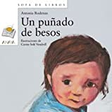img - for Un Punado De Besos / A Handful of Kisses (Sopa De Libros / Soup of Books) (Spanish Edition) book / textbook / text book