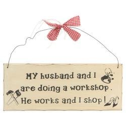 "Home Decor, Signs, 10""x4"" Wooden Sign Decor - Shopping. 10""x4"" Wooden Sign Plaques for Your Home. Adds a Great Touch to Any Home. The Sign Says ""My Husband and I Are Doing a Workshop. He Works and I Shop!"" Painted to Look Like an Antique. Comes Ready to Hang with Wire and Bow As Shown in Picture. - 1"