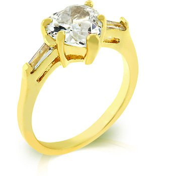 14k Gold Bonded Anniversary Ring Featuring Prong Set Heart Cut Clear CZ and Bar Set Clear Baguettes to Finish the Triplet in Goldtone