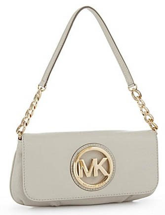 Michael Kors Fulton small shoulder tote handbag made from vanilla leather  with a single chain handle. Bag is finished with gold toned hardware efbc5e952ac06