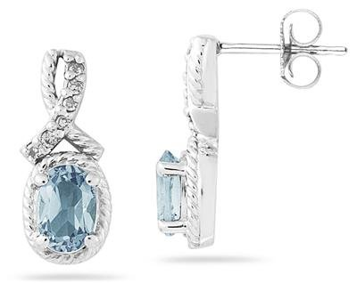 Oval Shaped Aquamarine and Diamond Earrings in White Gold