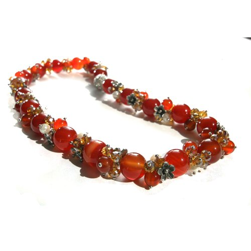 17 Inch Strand Necklace of Orange Marble Beads with Pearl, Orange Bead and Silver Flower Clusters and a Round Silver Magnetic Clasp Inlaid All Around with Diamantes.