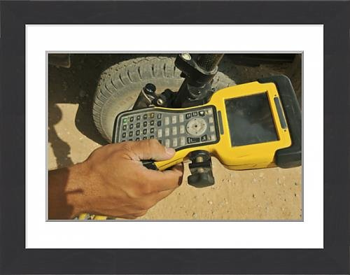 framed-print-of-us-air-force-technician-using-a-global-positioning-system-device
