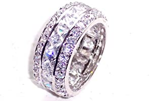 HIGH END DESIGNER ETERNITY RING WITH PRINCESS CUT 4X4MM SWAROVSKI ELEMENT CRYSTALS SURROUNDED BY BRILLIANT ROUND CRYSTALS. RHODIUM BONDED LUXURY QUALITY. BEST SELLING EYE CATCHING RING