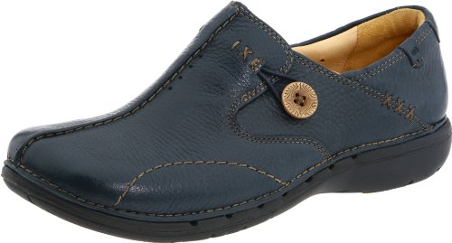 "The Clarks Unstructured Women's Un.Loop Slip-on features full-grain leather upper, removable leather insole, lambskin lining, stitched overlays and button detailing, 1"" heel, 1/2"" platform, and unique ventilation system."