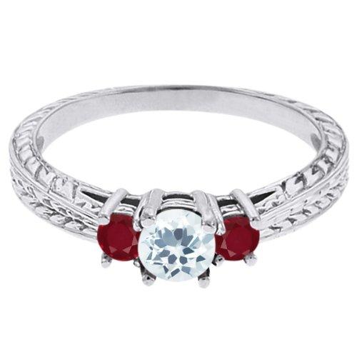0.61 Ct Round Sky Blue Topaz Red Ruby 18K White Gold 3-Stone Ring