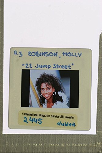slides-photo-of-close-up-of-american-actress-and-model-holly-robinson-peete-while-smiling