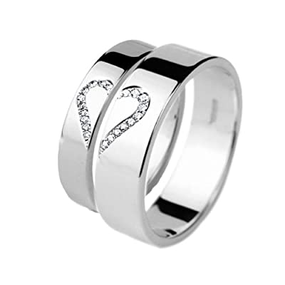 Wedding Rings His and Hers White Gold Diamond Set. A set of Wedding Bands That Create A Heart When Placed Together.