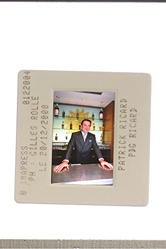 slides-photo-of-patrick-ricard-standing-in-the-mini-bar-of-house-2000