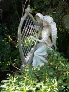 Fairy garden ornament with solar led light up harp