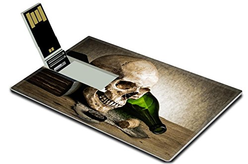Luxlady 16GB USB Flash Drive 2.0 Memory Stick Credit Card Size IMAGE ID: 25518475 Still life human skull with knife