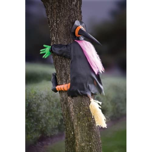 witch flying into a tree decoration.