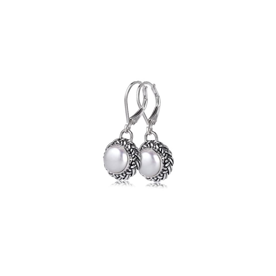Sterling Silver These sterling silver white mother of pearl earrings by Sara Blaine are versatile enough to compliment your best power suit as well as your sassiest little black dress Dangle Earrings Jewelry