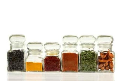 Glass Jars with Colorful Herbs and Spices. - 60