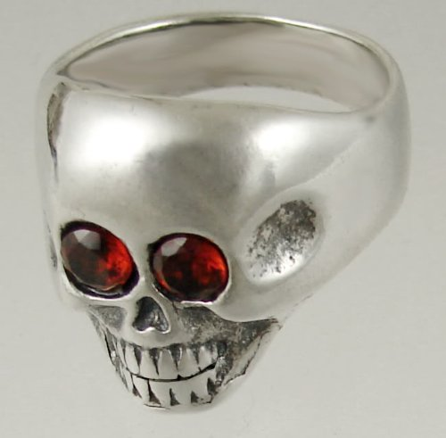A Striking Sterling Silver Skull Featuring Two Faceted Garnet Gemstone Eyes