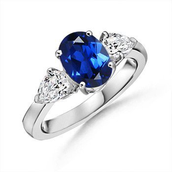 Oval Lab Created Sapphire and Simulated Diamond Three Stone Ring in 10k White Gold