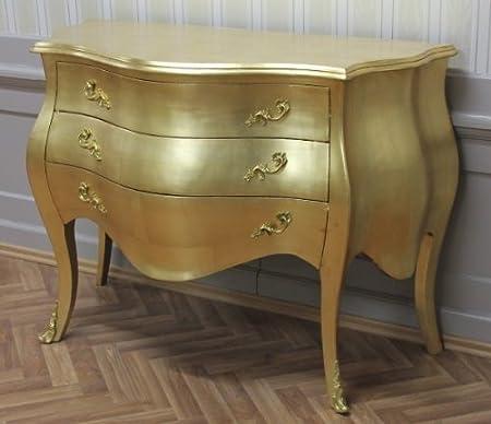 Cómoda en dorados al estilo barroco
